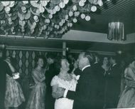 Juliana with Prince Bernhard dancing in party.