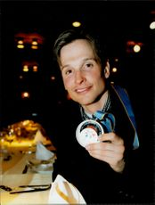 Cross-country skier Niklas Jonsson proudly shows his medal from the cross-country skiing 50 km during the Winter Olympics 1998