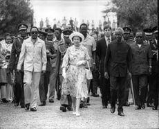 Queen Elizabeth II together with President Julius Nyerere accompanied by Prince Andrew after arriving at Dar es Salaam airport