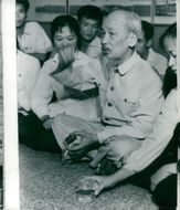 President Ho Chi Minh talks with a group of young people in Hanoi