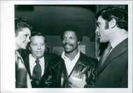Jo Ann Pflug, Wendell Niles Jr., Rams footballer Kermit Alexander and former pro-football star turned actor, Mike Henry at Niles' party for film and sports friends at the bistro.