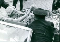 Princess Beatrix of the Netherlands waving in car.