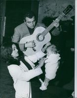José Luis Gonzalvo playing guitar for her wife, La Chunga while she dances their daughter. 1962.