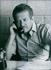 Ezer Weizman talking from a telephone in 1977.