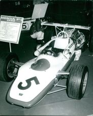The Honda F-I RA302 race car displayed on a car show.  Taken - Circa 1968