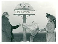 Mrs.  Angela Roxburgh unveiling the Islington sign.