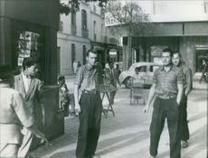 Men standing in the street.
