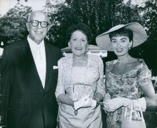 Jimmy McHugh photographed with women.