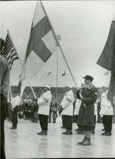 Fan carrier at the opening ceremony during the 1952 Winter Olympics