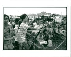 Vietnamese refugee wait for water and food.