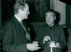 Sir Peter Vanneck, the Lord Mayor of London (1977-78), in conversation with the Deputy Mayor of Peking, Wang Hsiao-yi, at the Lord mayor's residence. 1978