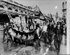 Demonstration against Asian immigrants leaves Smithfield Market to continue through London.