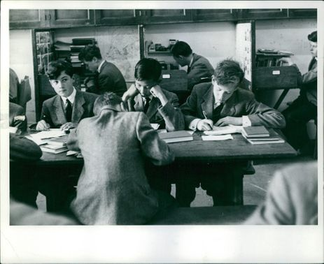 Young boys inside the library.