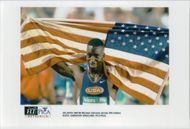 Michael Johnson with the American flag after the 400m win during the Olympic Games in Atlanta in 1996