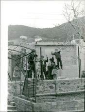 Children talking to an American soldier inside the fence. Photo taken in Marc 1962.
