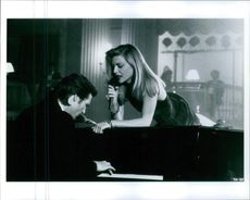 """Michelle Pfeiffer singing while Jeff Bridges playing the piano during a scene from the film """"The Fabulous Baker Boys""""."""