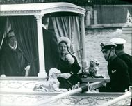 Queen Juliana of the Netherlands on a boat with her security guards.
