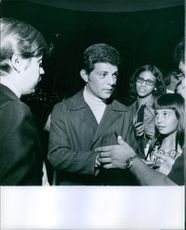 Frankie Avalon meeting and signing an autograph with his fans.