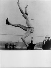 Man competing in High Jump.