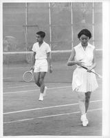 Crown Prince Akihito and Crown Princess Michiko at a lawn tennis court