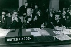 A photo of Admiral of the Fleet Louis Francis Albert Victor Nicholas Mountbatten, 1st Earl Mountbatten of Burma, in a conversation during a press conference, 1954.