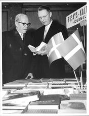Danish ambassador Anthon Vestbirk admire one of the books in Danish bokutställningen