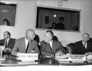 Yul Brynner talking to high commissioner for refugees.