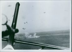 Italian Torpedo plane in action against a German warship.