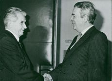 President Ceausesco meeting and shaking hands with Mojsov.