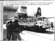 Armed Lebanese army supervise the unloading of the Red Cross aircraft with medical supplies at Beirut airport