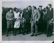 Stanley Baldwin being welcomed by people in street during an event.