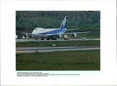 Aircraft Skyjack All Nippon 747 with 165 people on board parked on the runaway at Hakodate.