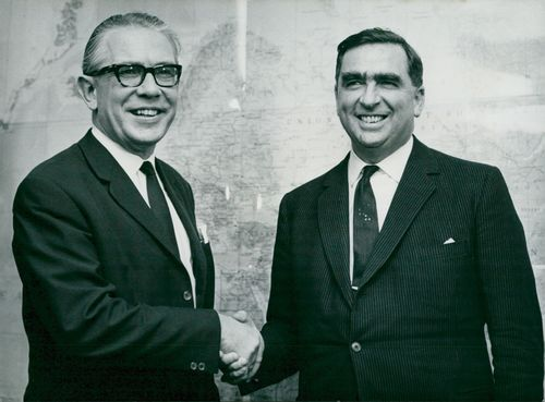 West German Defense Minister Herr Von Hassel shakes hands with Denis Healey