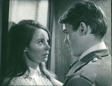 William Frank Jones and Sarah Miles looking at each other.