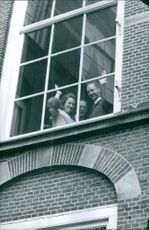 Carlos Hugo and Princess Irene of the Netherlands waving through the window.