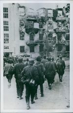 Sebastopols Fall.  1942  Russian prisoners aterforas to the city, which is no longer a city.