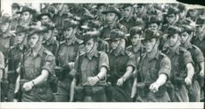 Australian servicemen marching before leaving by air for Vietnam
