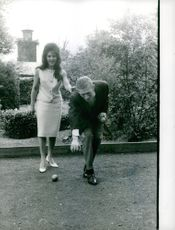 Dalida and a man playing with ball.