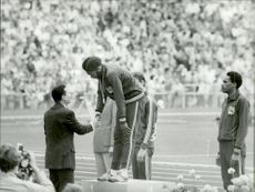 Muburn congratulations to the gold in the men's 110m hedge during the 1972 Olympics