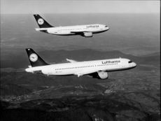An Airbus A310-300 with an Airbus A320-200. Both plans belong to Lufthansa.