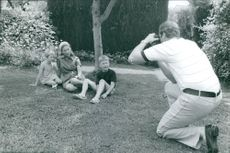 Prince Albert II clicking photographs of his family.