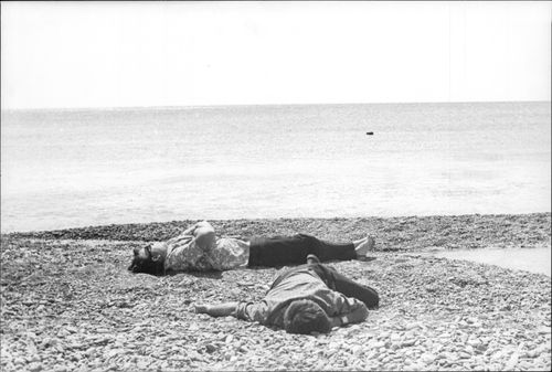 Two men are sleeping at the Black Sea