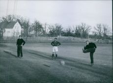 Players gathered while playing a football in the field, 1943.
