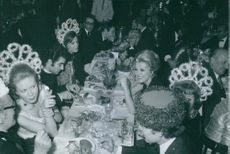 Prince Jacques of Orléans with his wife Gersende Thérèse de Sabran-Pontèves having dinner with other people.