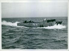 Whilst travelling on the coast which they are to invade, the barges show no sign of the number of the Marines which they carry.