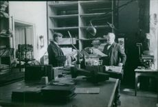 Two men having a conversation in the laboratory.