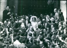 Carlos Hugo and his wife Princess Irene surrounded by people during their wedding day.