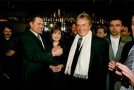 Actor Alain Delon greets his friend General Alexander Lebed and his wife Inna