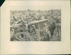 A illustration of soldier with cannon in the field during First World War.