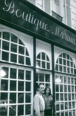 Prince Andre de Bourbon-Parme with his wife, Marina Gacry standing in front of building. 1965.